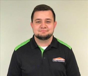 Crew Chief with SERVPRO polo shirt